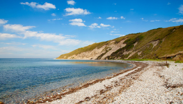 Nordøens sten og sandstrande.Feature